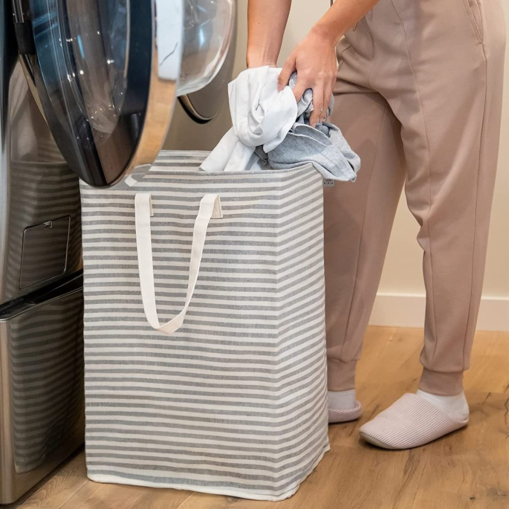 person taking laundry out of a hamper