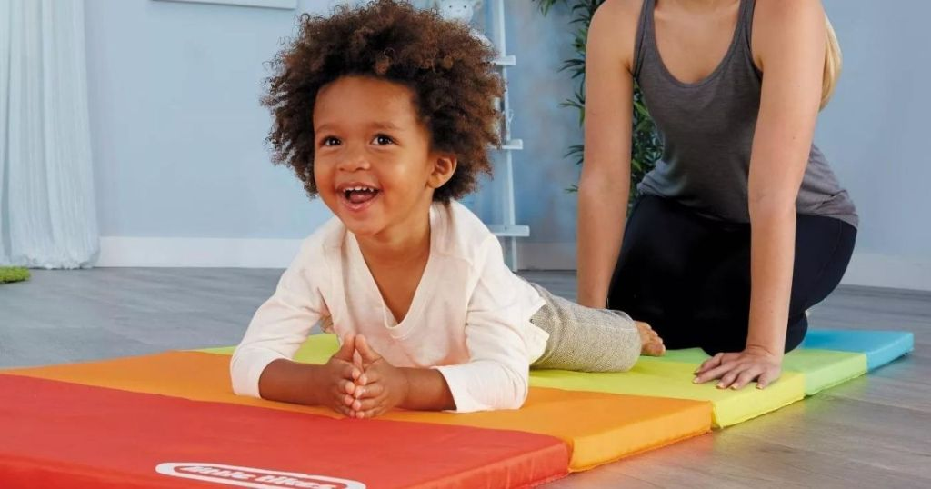 kid laying on a play mat