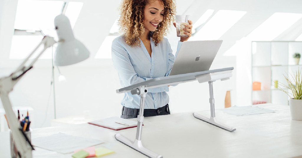 Woman using Laptop Bed Tray Desk standing up
