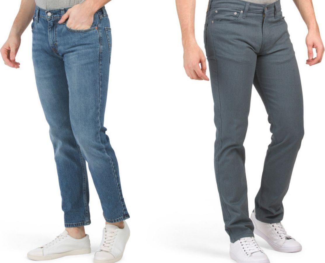 two men wearing jeans