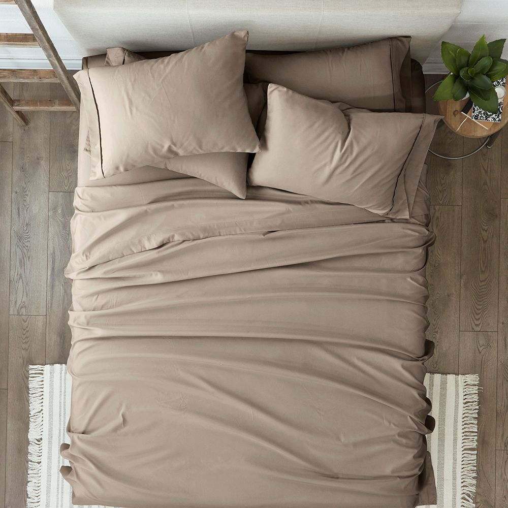 bed with sheets and pillows on it