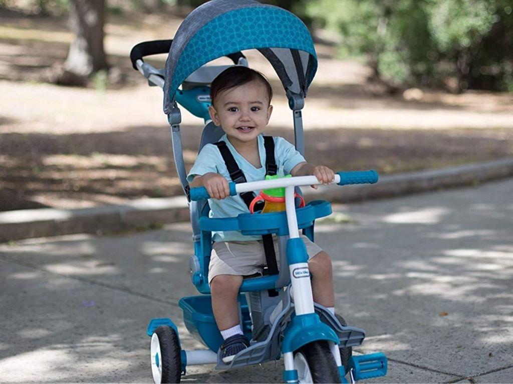 little boy using Little Tikes 3-in-1 Push Trike