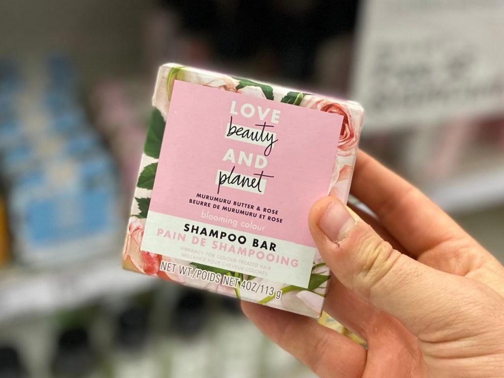 hand holding a shampoo bar