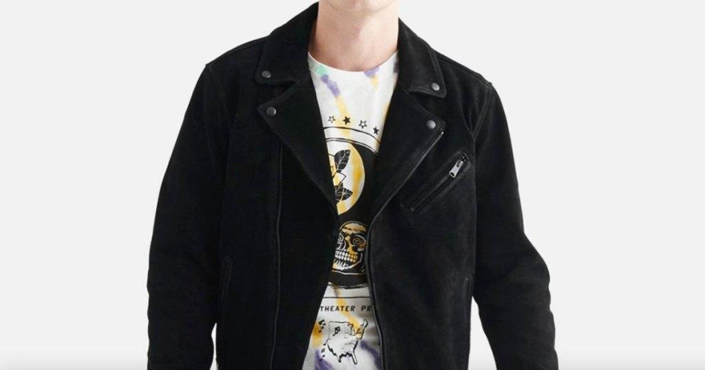 man in black jacket and tie dye tee