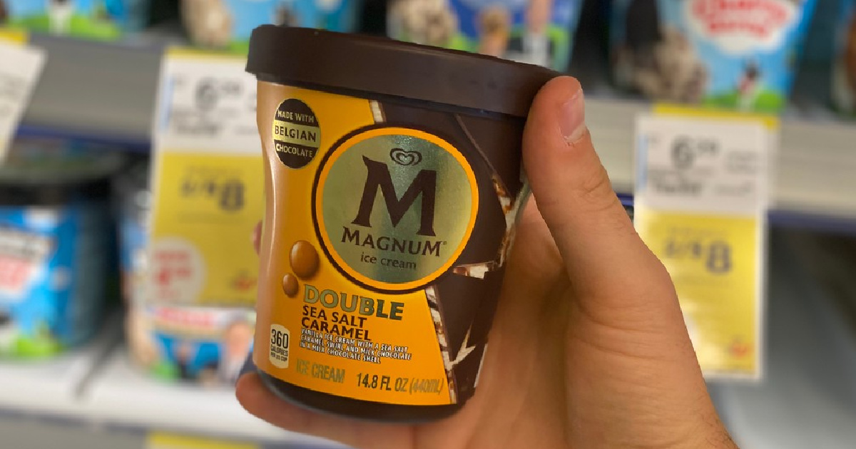hand holding up a pint of magnum ice cream