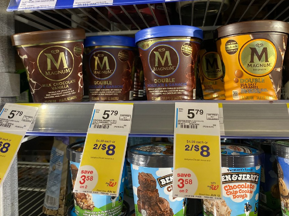 pints of magnum ice cream on a walgreens cooler shelf above ben and jerrys pints