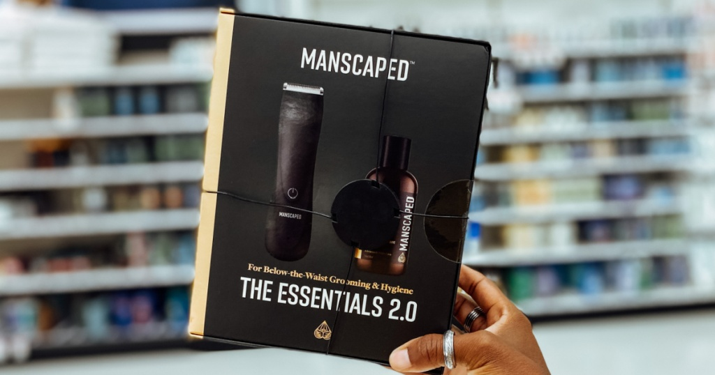 hand holding black box of men's grooming essentials