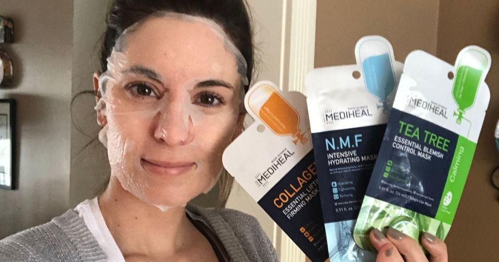 woman holding face masks