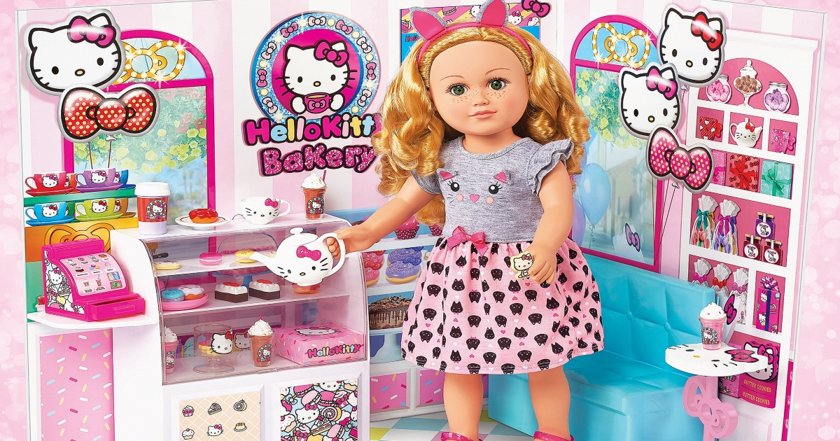 Doll in a bakery playset. it is pink and white