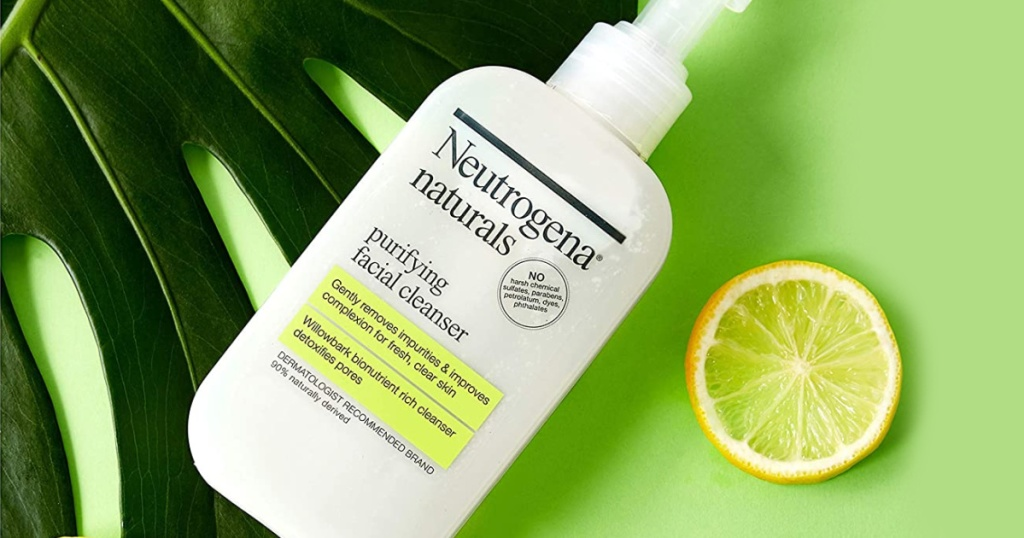 natural facial cleanser from Neutrogena near palm leaf and lemon slice