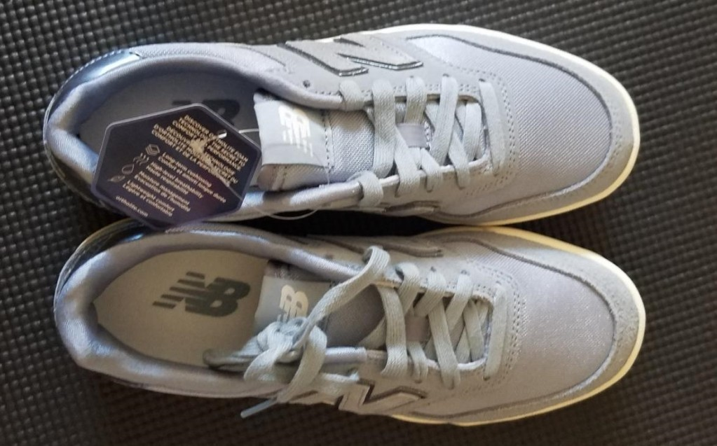 pair of grey New Balance Sneakers
