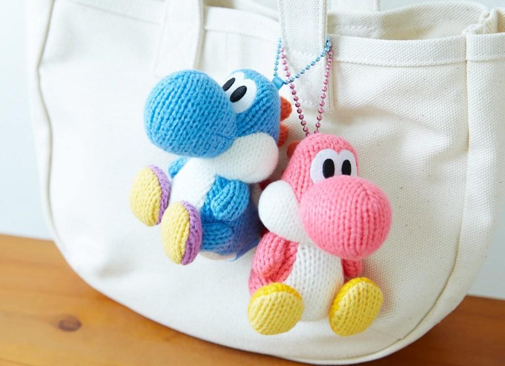 yarn yoshi's hanging from a bag