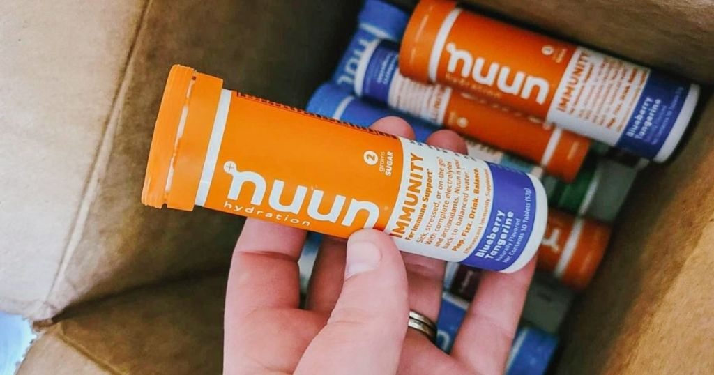 hand taking nuun tube from box