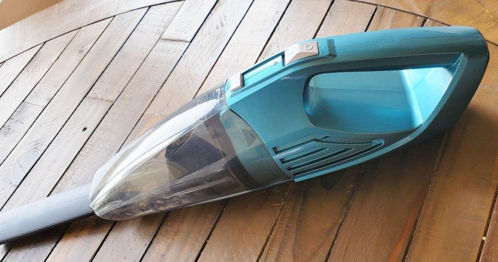 handheld vacuum on wood table