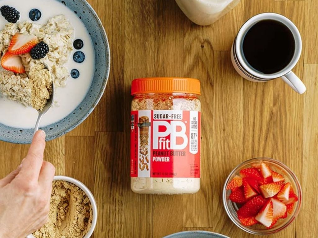 PB Fit powder on table surrounded by food