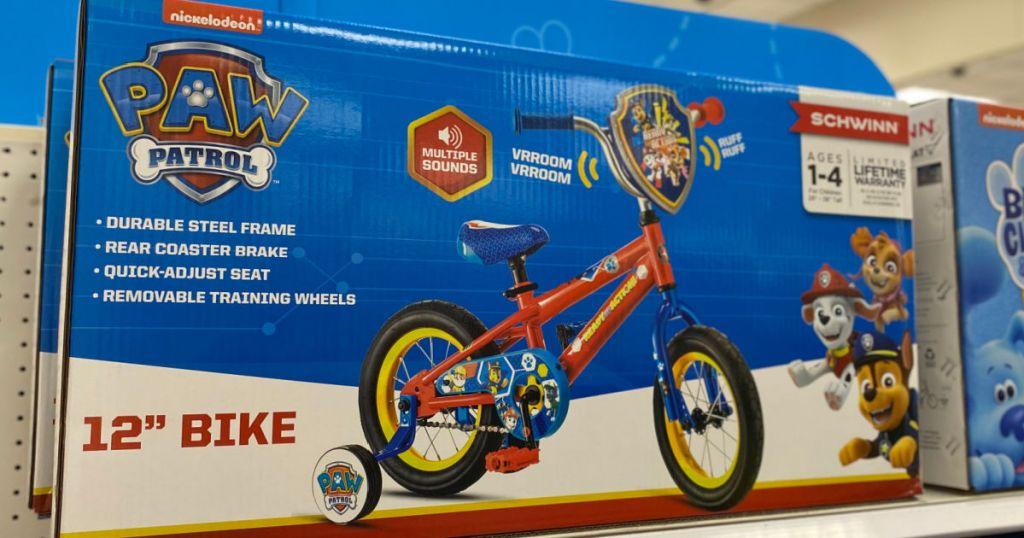 blue box with kids bike on shelf