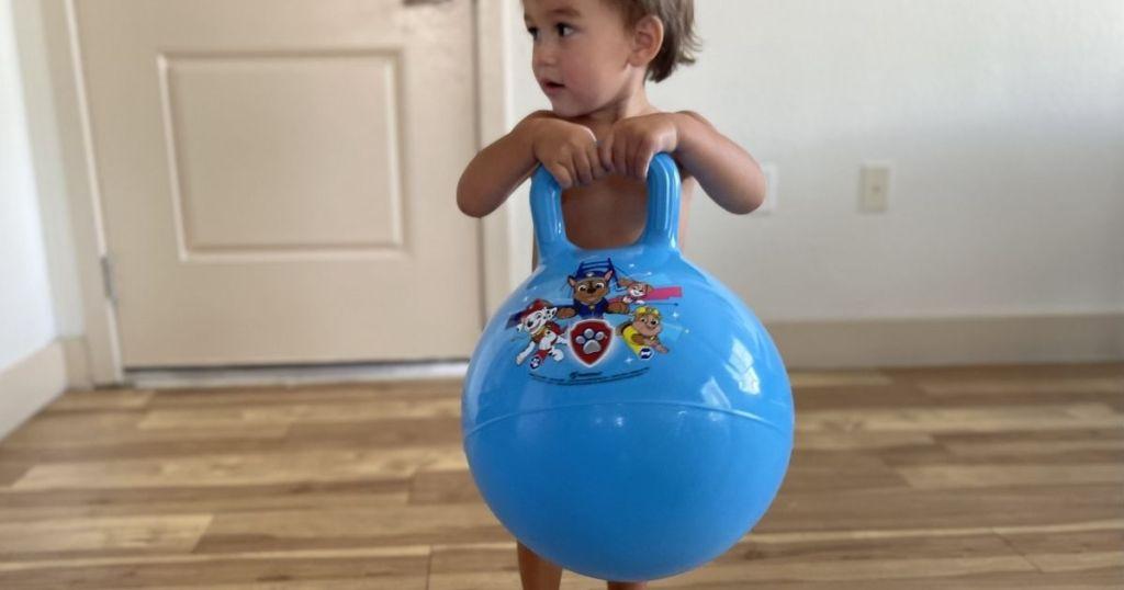 boy holding a toy hopper
