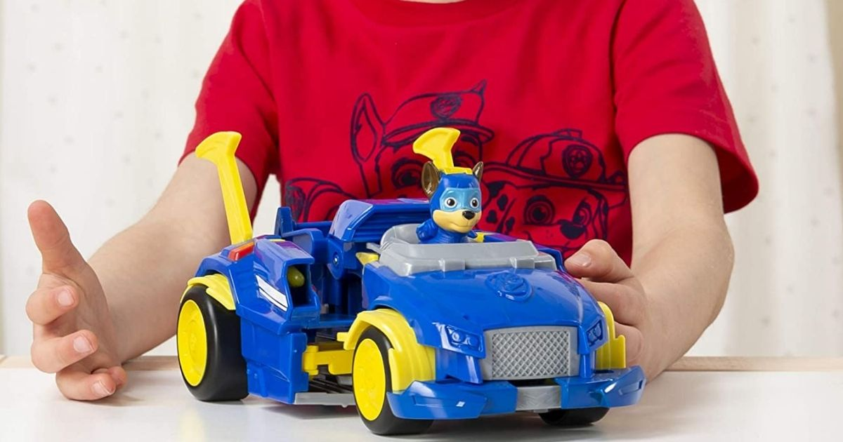 boy in a red t-shirt playing with a Paw Patrol Toy