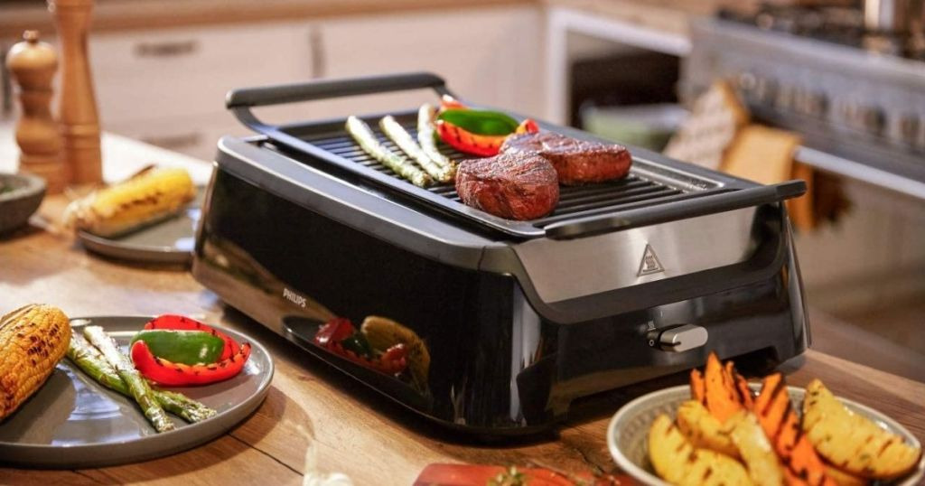 smokeless grill with food on it