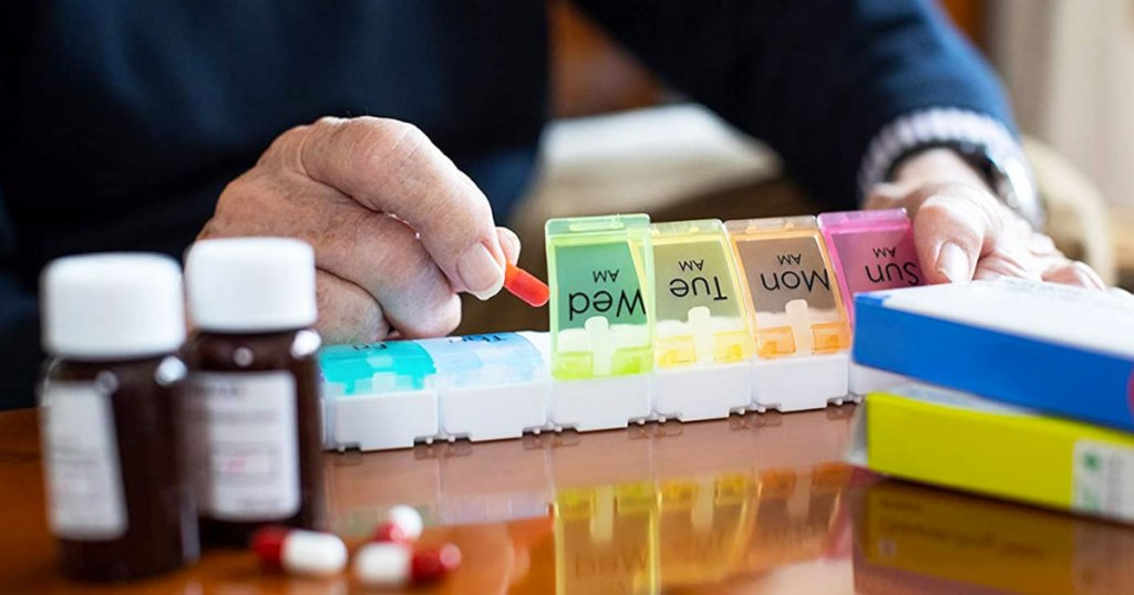 putting pills into colorful organizer