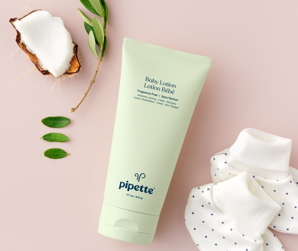 Pipette Baby Lotion with baby booties by it