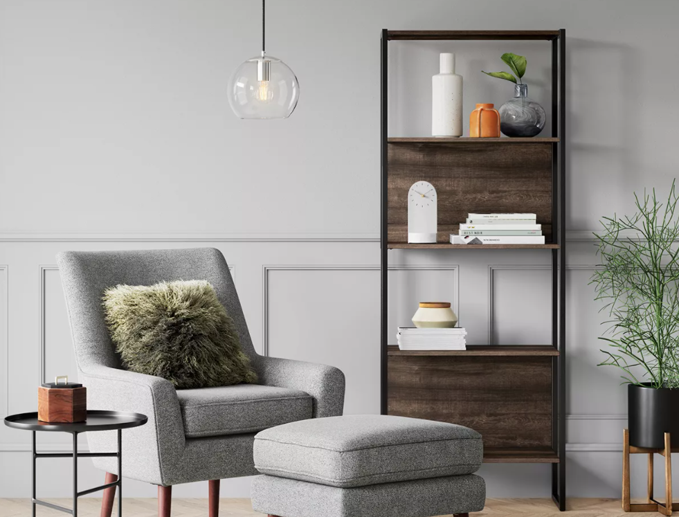 living room with chair and bookshelf