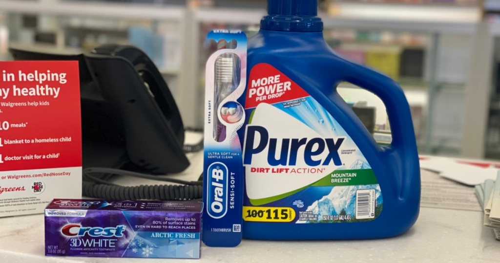 toothpaste, toothbrushes and detergent on counter
