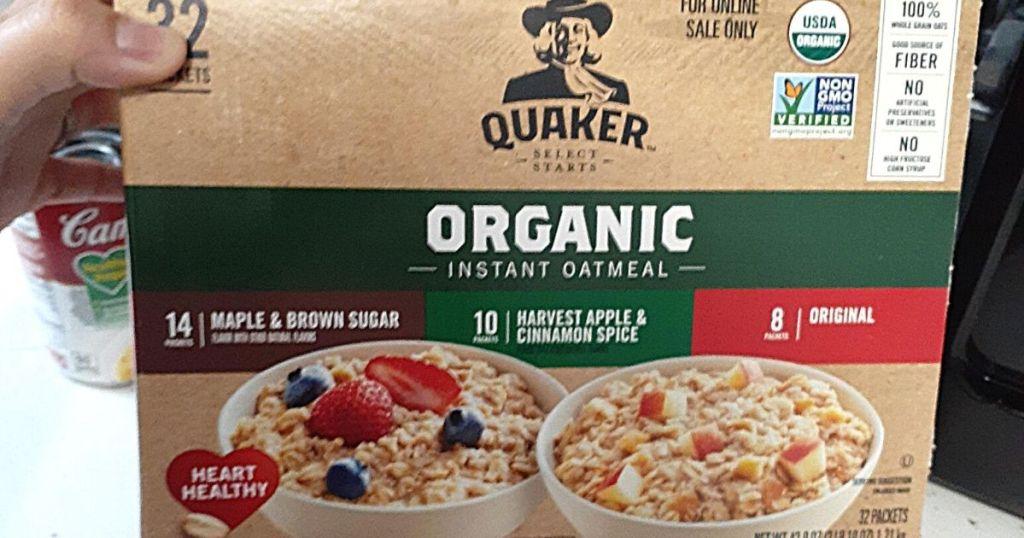 hand holding Quaker organic instant oatmeal box