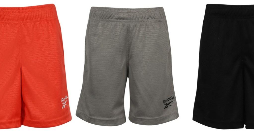 three pairs of boys basketball shorts