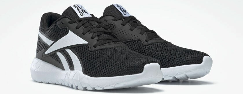pair of black and white Reebok sneakers