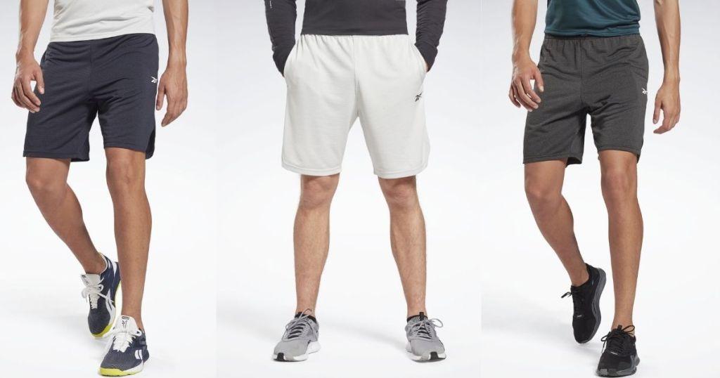 three men wearing shorts