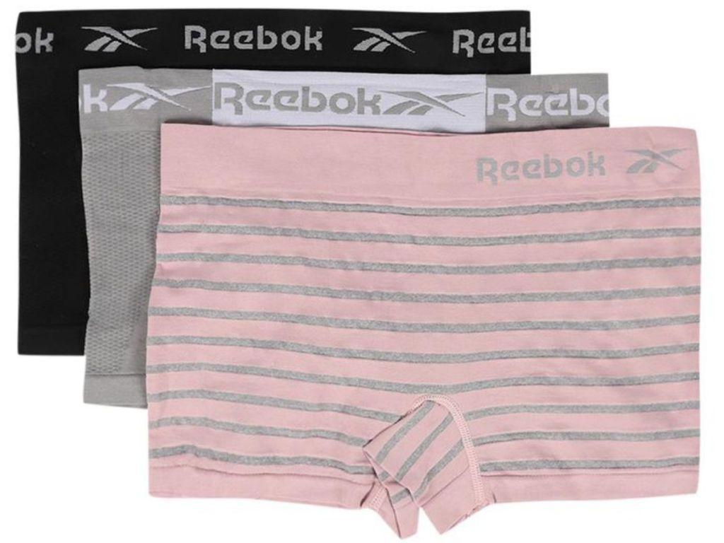 black, gray and pink and gray striped Reebok boy shorts