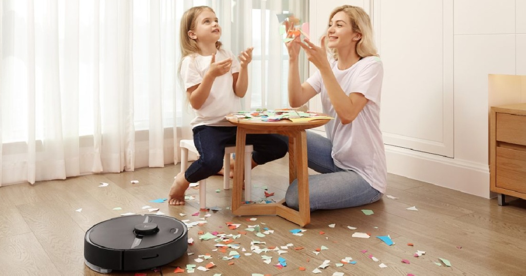mom and child playing while Roborock S6 Robot Vacuum cleans