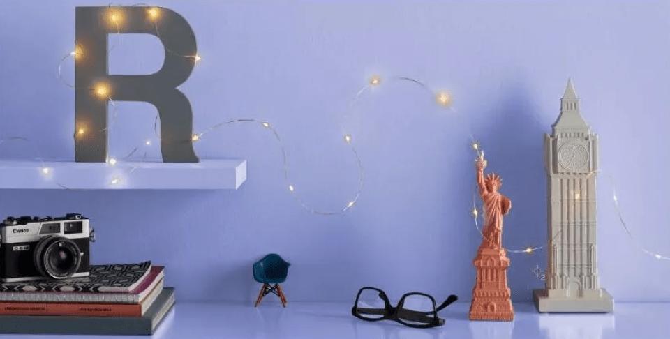 fairy lights on a shelf and desk