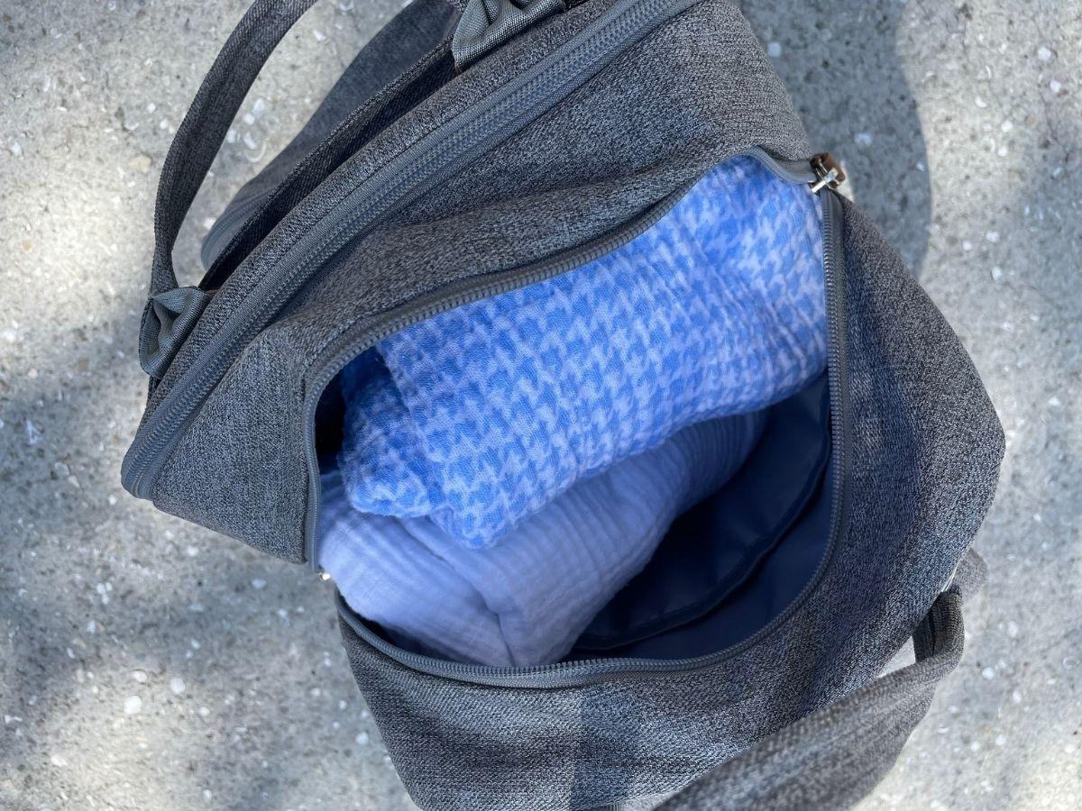 opened grey diaper bag backpack