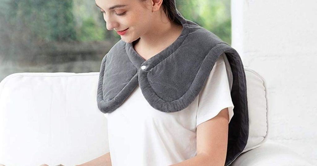woman wearing a heating pad on her shoulders