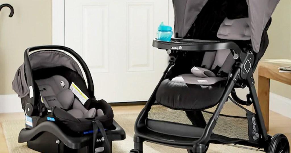 gray baby car seat and stroller in front of door