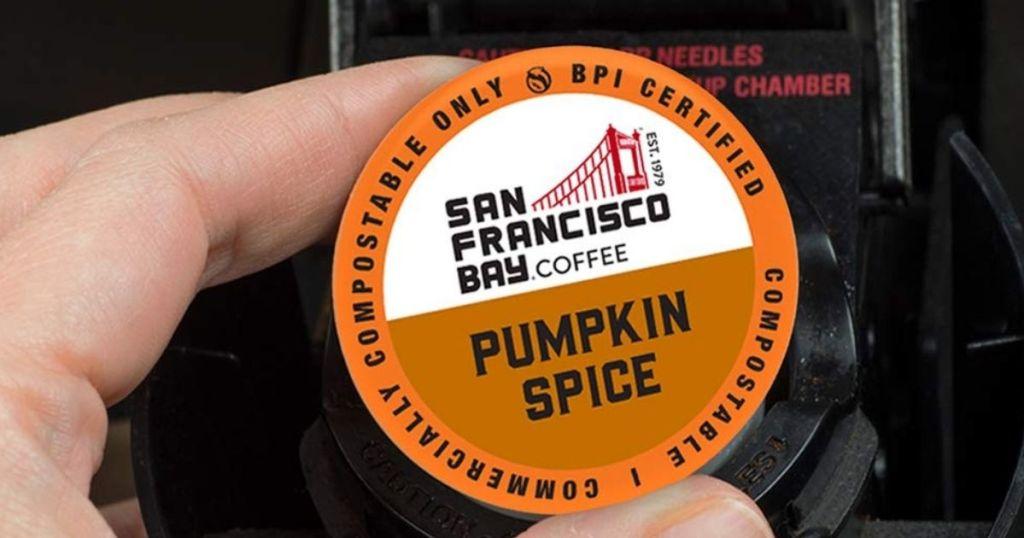 hand holding San Francisco Bay coffee pumpkin spice pod