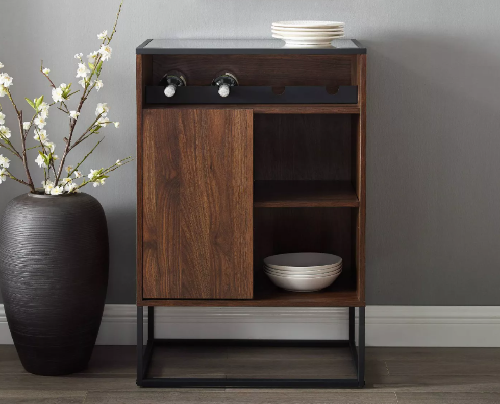 wine cabinet with planter next to it