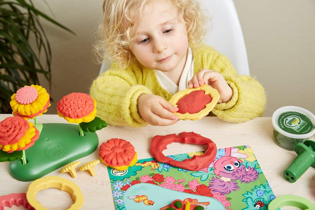 girl playing with a dough set