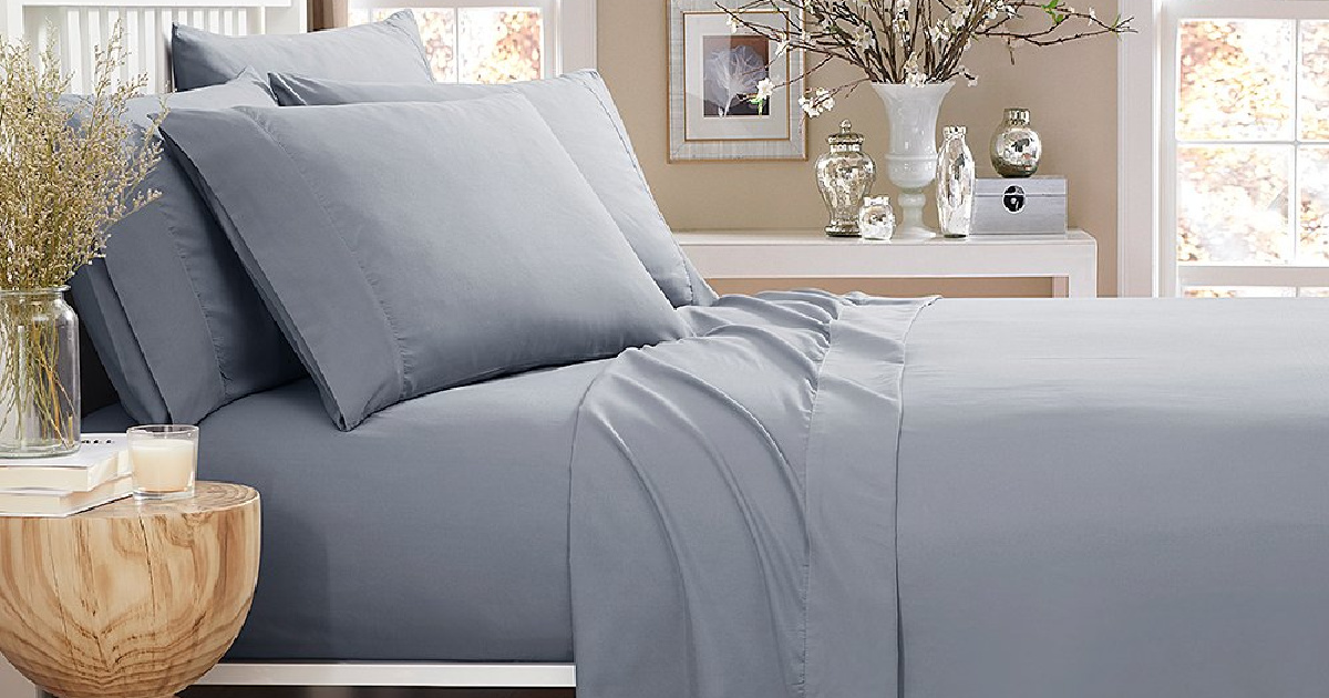 bed with gray sheets