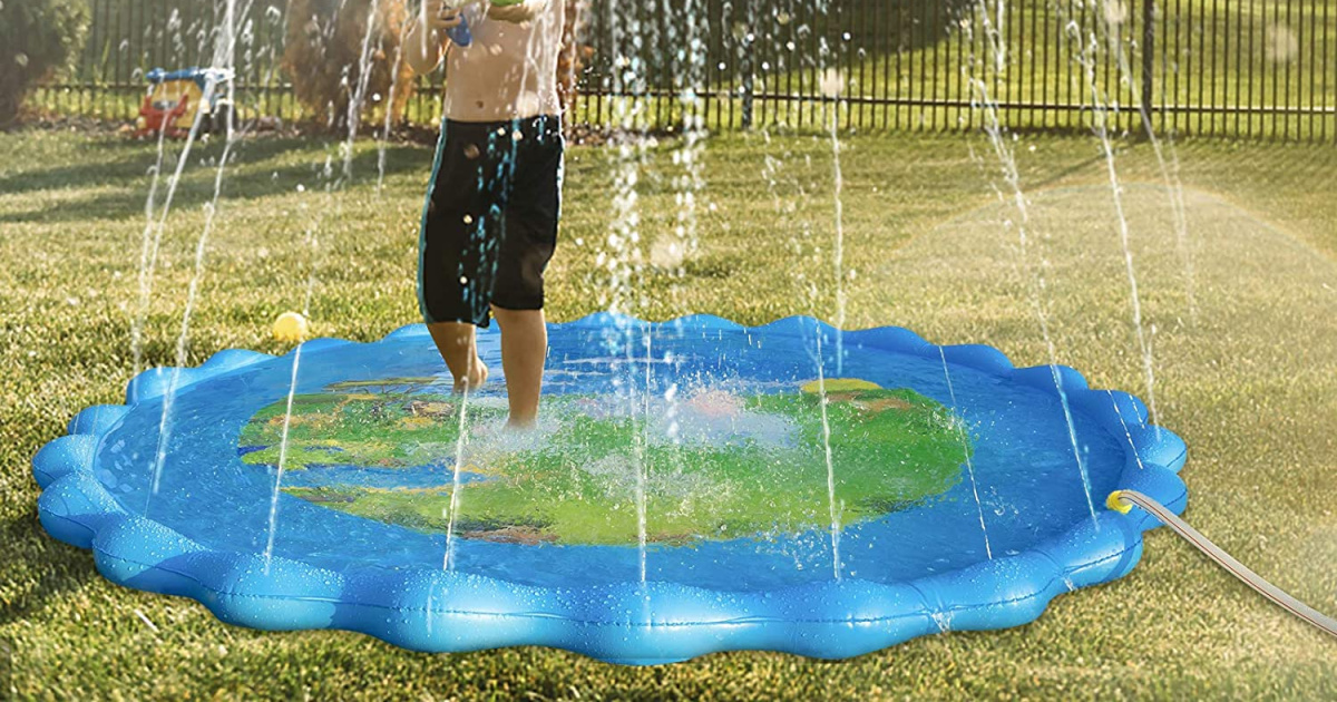 kid playing in splash pad in yard