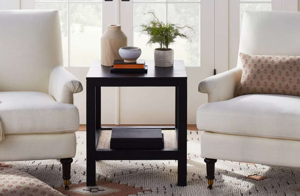 side table between two chairs