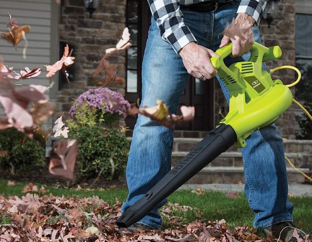 man using a leaf blower