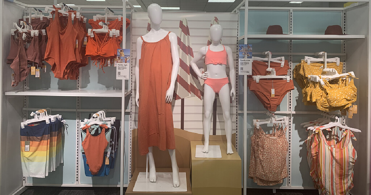adult and kids matching swimwear on a target display wall