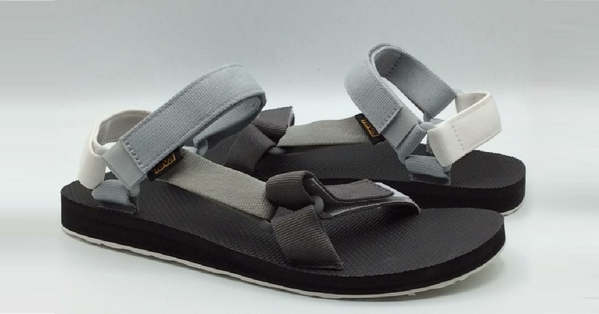 black and gray teva mens sandals against a gray background