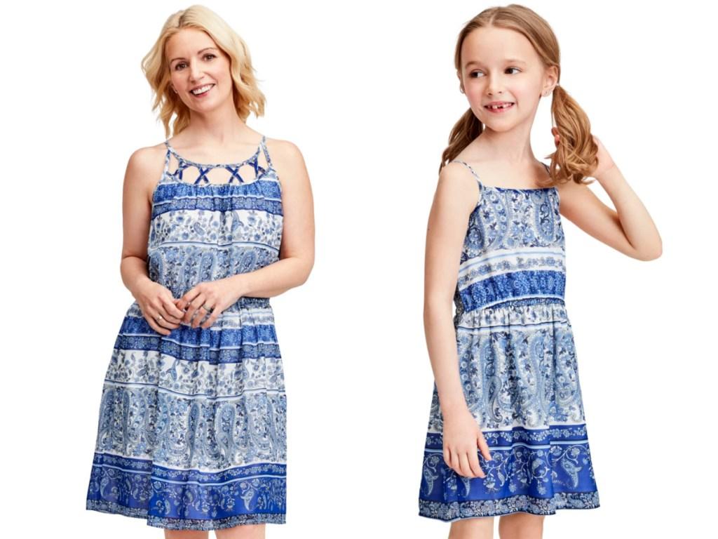 woman and little girl wearing blue sun dresses