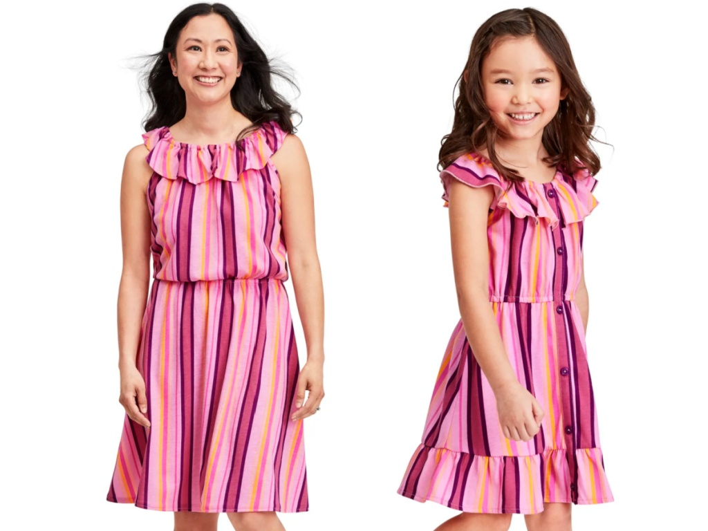 woman and child wearing matching pink dresses