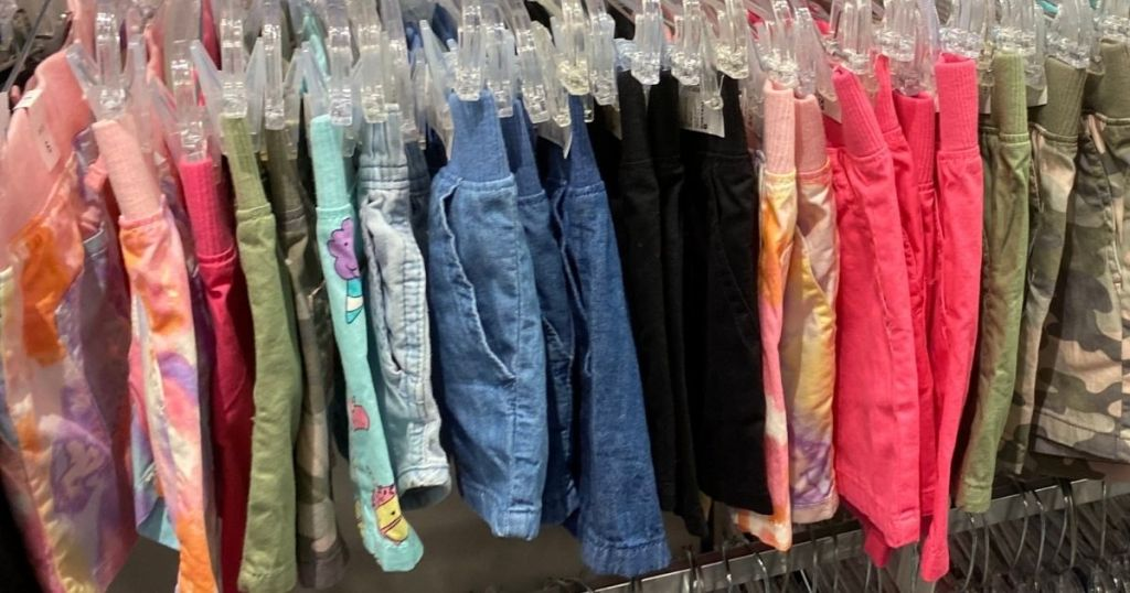 row of shorts on hangers