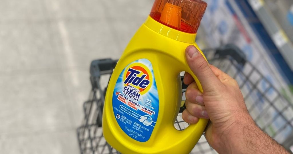 hand holding a bottle of Tide